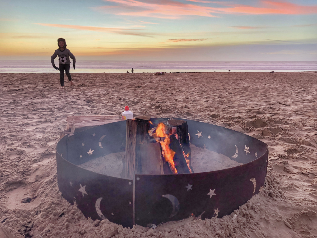 So many things to do in SLO like a beach bonfire on Grover Beach