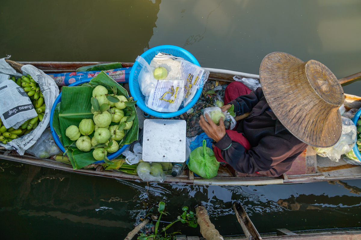 You must visit a floating market in Bangkok with Kids