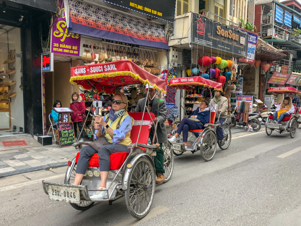Tour through Old town on a cyclo while in Vietnam with kids