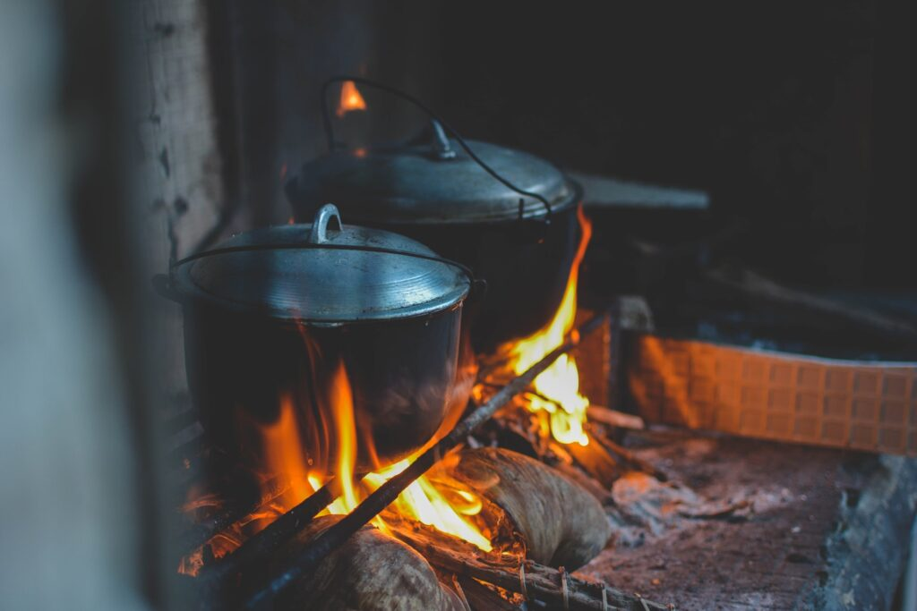Dutch Oven cooking over the fire is a great easy camping meal for the whole family