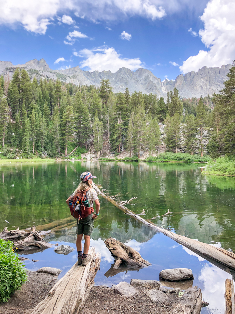 boy looking out at Emerald Lake - a great hike in Mammoth Lakes