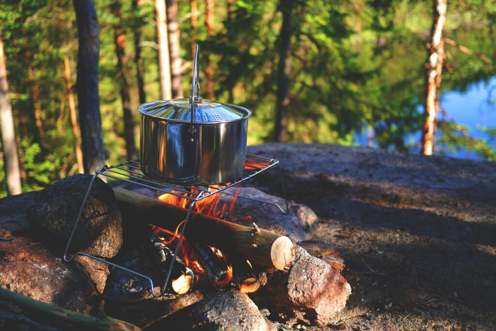 cooking over the fire, a car camping fire essential
